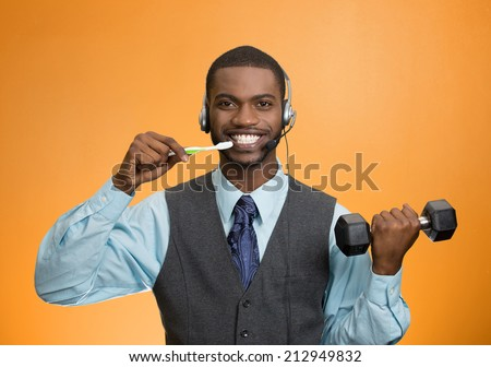 Multitasking businessman. Closeup portrait corporate business man talking on phone, brushing teeth, lifting dumbbell isolated orange color background. Face expression, emotion. Phone addiction concept - stock photo