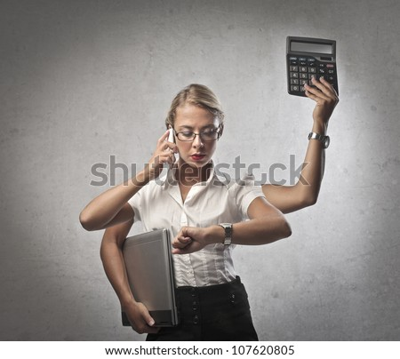 Multitasking young businesswoman doing many things at the same time