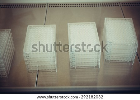 Multiwell platen in flow box as background, soft focus - stock photo