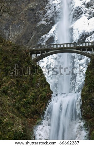 Multnomah Waterfalls frozen in winter. Columbia River Gorge National Scenic Area, Oregon. - stock photo