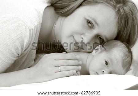 Mum and a newborn baby - stock photo