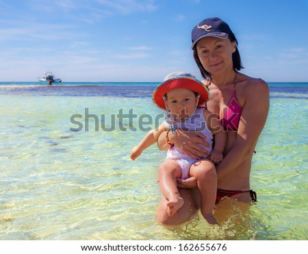 Mum and baby on the beach in Rottnest Island, Australia - stock photo