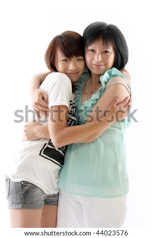 mum and daughter having fun, isolated on white background - stock photo