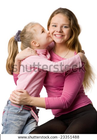 Mum and the daughter in pink clothes, daughter kisses mum, isolated on white - stock photo