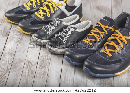 Mum dad and son sizes shoes in family love concept - stock photo