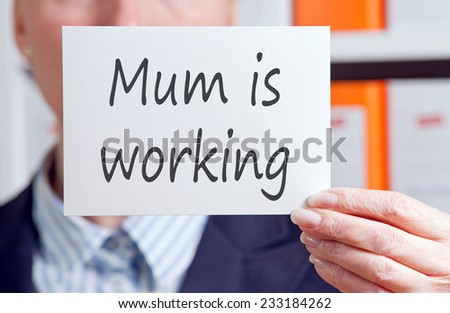 Mum is working - Businesswoman in the Office - stock photo