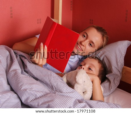 Mum puts to bed a sonny 6 - stock photo