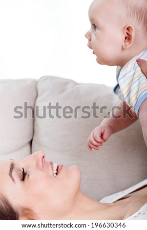 Mum spending time with her baby, vertical - stock photo