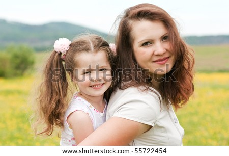 Mum with a daughter on the nature - stock photo