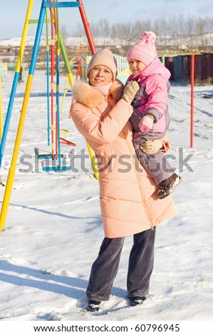 Mum with a daughter on walk, a frost - stock photo
