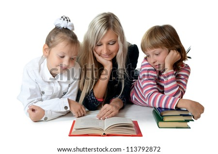Mum with a daughter read the book - stock photo