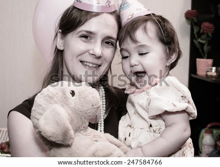 Mum with the child at a birthday party  - stock photo
