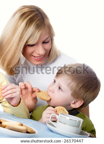 Mum with the son drink tea with cookies - stock photo