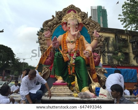 Mumbai, India - August 20, 2016 : a procession with large crowds during Hindu Lord Ganesha chaturathi festival along the street
