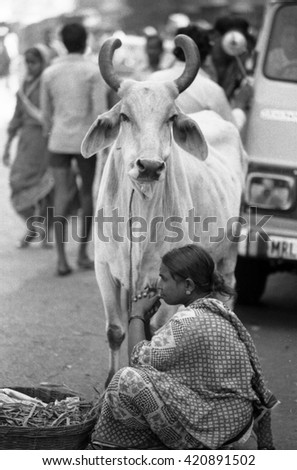 MUMBAI, INDIA - FEBRUARY 15, 1984: lady in a parking lot near the biggest open air city market. The place is everyday populated by thousands of people. - stock photo
