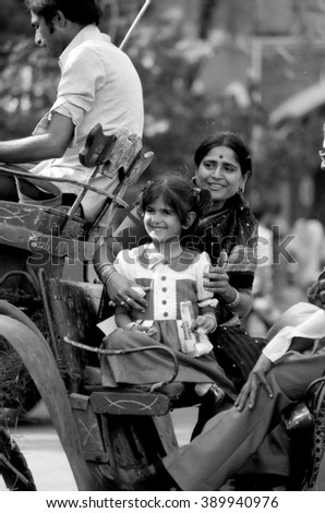 MUMBAI, INDIA - FEBRUARY 15, 1984: mother and daughter  arriving in the biggest open air city market. The place is everyday populated by thousands of people.