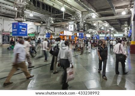 MUMBAI, INDIA - FEBRUARY 21: Unidentified people inside Chhatrapati Shivaji Terminus on Febuary 21, 2014 in Mumbai, India - stock photo