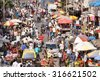 MUMBAI, INDIA - JANUARY 5, 2014: Huge crowd shopping at Mumbai market. - stock photo