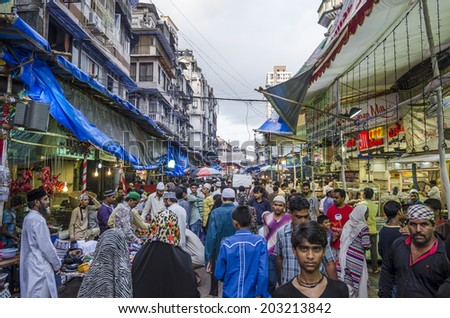 Mumbai, India - July 3, 2014 -  People shopping for food from stalls at at crowded Mohammad Ali Road in the evening during Ramzan fasting month - stock photo
