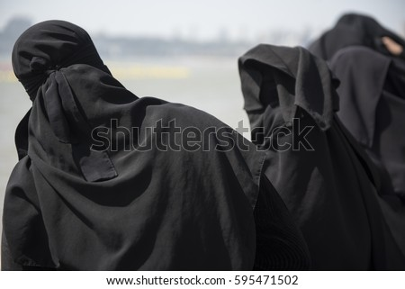 Muslim women at the beach in burkas