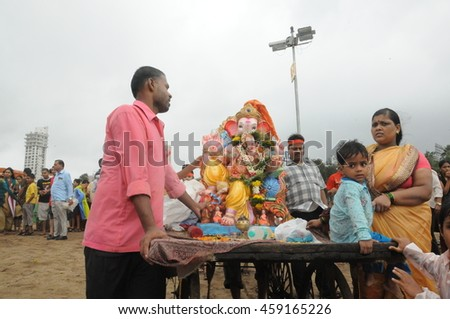 MUMBAI, INDIA - 14 SEPTEMBER 2015 : Thousands of devotees bids adieu to Lord Ganesha in Mumbai during Ganesh Visarjan which marks the end of the ten-day-long Ganesh Chaturthi festival. - stock photo