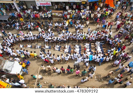 MUMBAI, MAHARASHTRA, INDIA - 25 AUGUST 2016 : Crowd of young of People gather together for enjoying and dancing during the Dahi Handi festival to celebrate God Krishna's Birth in Mumbai