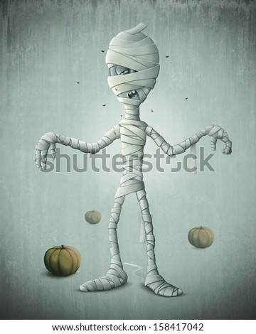 Mummy and pumpkins for halloween creepy night - stock photo
