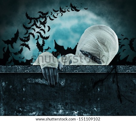 Mummy gets out of the coffin - stock photo