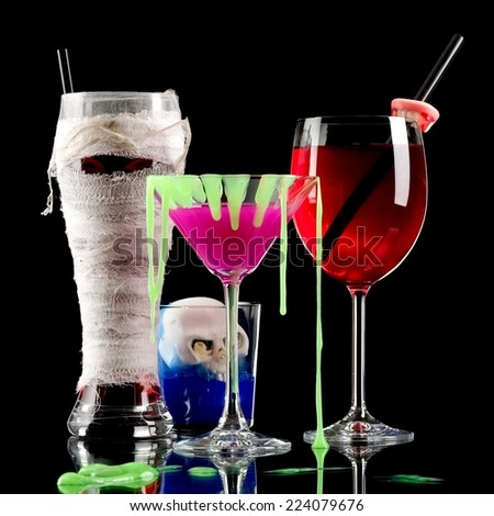 Mummy, pink and red Halloween cocktails with skull - stock photo