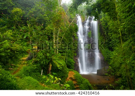 Munduk Natural Waterfall, that you will encounter first when you come from the direction of Depansar.The waterfall is located about 1 km from Restaurant Ngiring Ngawedang. Indonesia, Bali