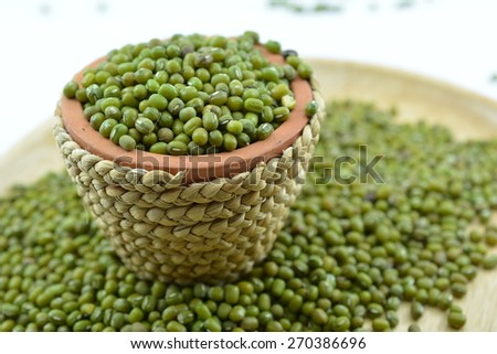 Mung bean is a plant species in the legume family. It is used as an ingredient in both savory and sweet dishes. - stock photo