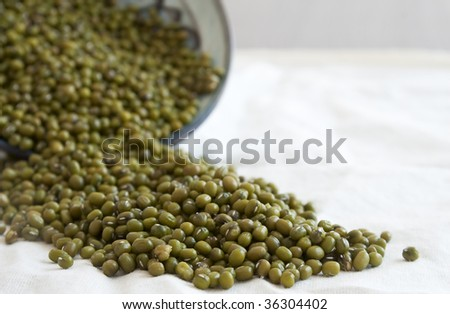 mung bean spilling from a ceramic bowl