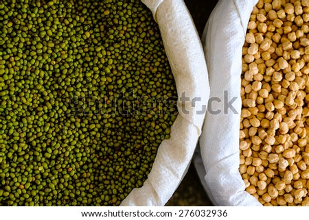 Mung beans and chick-pea in the sacks - stock photo