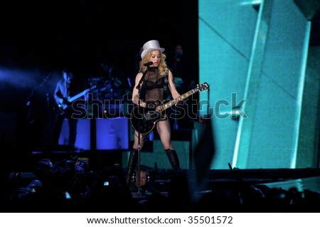 MUNICH - AUGUST 18: Singer Madonna performs onstage at Olympic Stadium, 'Sticky & Sweet Tour' August 18, 2009 in Munich, Germany.