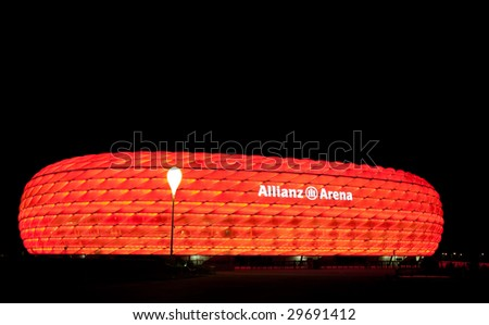 MUNICH – CIRCA SEPT 2008 : Colorful illumination of Allianz Arena, FIFA 2006 World Cup Stadium circa September 2008 in Munich. The stadium has nicknames such as UFO, rubber dinghy, and lifebelt.
