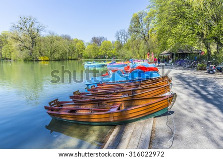 MUNICH, GERMANY - APR 20, 2015: boats for rent at the  Seehaus in Munich, Germany. This pier is placed at the Kleinhesseloher lake in the English Garden. - stock photo