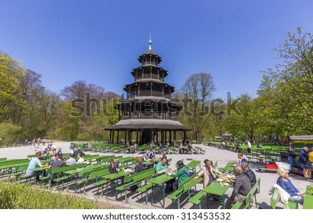 MUNICH, GERMANY - APR 20, 2015: people enjoy the  Biergarten near Chinese tower in English garden in Munich, Bayern, Germany. - stock photo