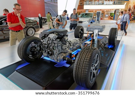 MUNICH, GERMANY - 4 AUGUST 2015:  BMW hybrid car model  - TwinPower Turbo 4-cylinder petrol engine combined with electric motor exhibited at BMW World showroom - stock photo