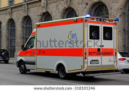 MUNICH, GERMANY - 4 AUGUST 2015: Emergency medical assistance vehicle in action. Number to call in case of emergency in European Union is 112.