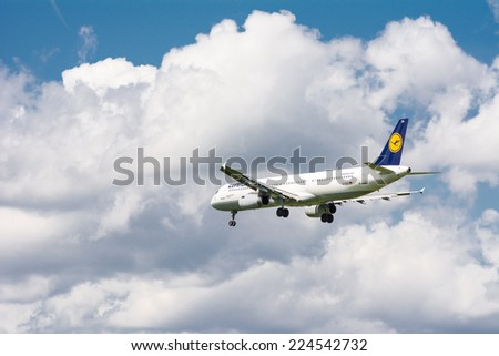 MUNICH, GERMANY - AUGUST 17: Lufthansa airbus A321 approaching the the airport in Munich, Germany on August 17, 2014. Munich airport has almost 40 million passengers a year. - stock photo