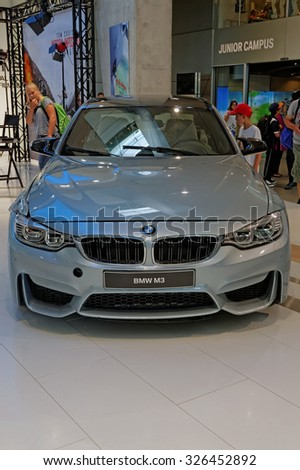 MUNICH, GERMANY - 4 AUGUST 2015: The original BMW M3 used in the film set of Mission: Impossible, Rogue Nation, starring Tom Cruise. BMW World showroom in Munich, Germany.