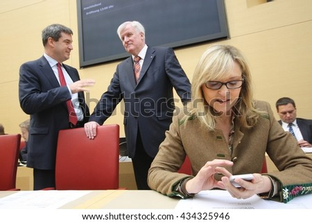 Munich, GERMANY - December 4, 2013: Horst Seehofer, Prime Minister of Bavaria, Markus Söder, Minister of finance, Beate Merk, Minister of European affairs in the plenar hall of Bavarian Landtag - stock photo