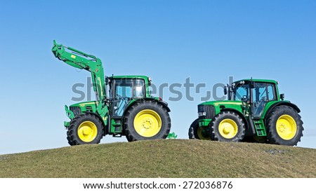 MUNICH, GERMANY - FEBRUARY 29 - A John Deere Model 6630 and 6430 - new tractors at a field at February 29, 2012 near munich - germany - stock photo