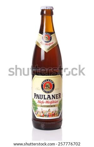 Munich, Germany - February 18, 2015: One bottle of Paulaner Hefe-Weissbier Naturtrueb wheat beer. Brewed by Paulaner Brauerei in Munich, Bavaria, Germany.                                - stock photo