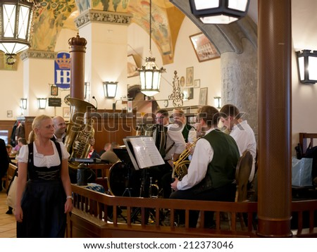 MUNICH, GERMANY- FEBRUARY 02, 2014: Unknown bavarian band in the most famous beer hall Hofbrauhause am Platz in Munich on February 02, 2014. During regular ours, traditional Bavarian music is played.