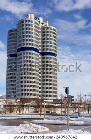 MUNICH, GERMANY - JANUARY 2: BMW Headquarters on January 2, 2015. The four vertical cylinders building is a Munich landmark which is world headquarters for the Bavarian automaker.  - stock photo