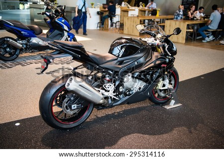MUNICH, GERMANY - JULY 1, 2015: BMW motorcycle at the BMW Welt, a customer experience and exhibition facility of the BMW AG, Munich, Germany