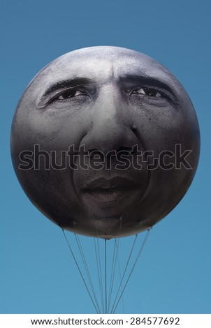 MUNICH, GERMANY - JUNE 5, 2015:  ONE is an International Campaigning and Advocacy Organization. More Than Hot Air with giant President Obama Balloon is directed at the 2015 Summit Meeting in Germany.  - stock photo