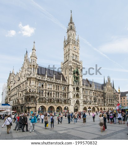 MUNICH, GERMANY - JUNE 4: Tourists at the Marienplatz in Munich, Germany on June 4, 2014. Munich is the biggest city of Bavaria  with almost 100 million visitors a year.  - stock photo