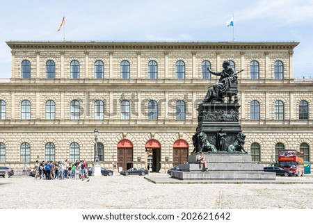 MUNICH, GERMANY - JUNE 4: Tourists at the Residence of  Munich, Germany on June 4, 2014. Munich is the biggest city of Bavaria  with almost 100 million visitors a year.  - stock photo